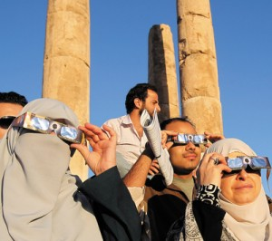 ALI JAREKJI/REUTERS Observers in Amman, Jordan, watch the transit of Venus across the Sun in June 2012.
