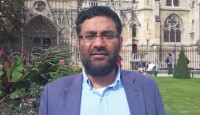 Usama Hasan in front of Notre Dame